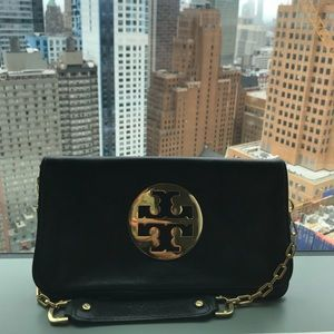 Authentic Tory Burch clutch with strap.